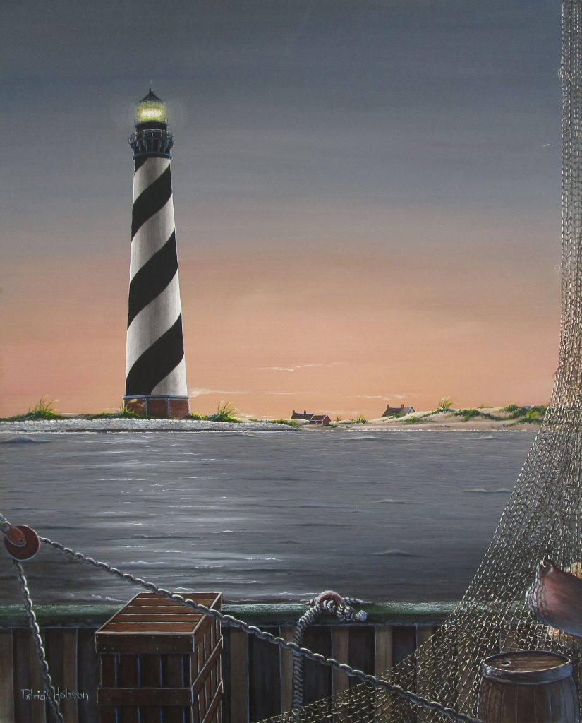 A nautical art print of the Cape Hatteras Lighthouse on the North Carolina Outer Banks. A view from a fishing boat on the way in after a long day as the sunsets behind the lighthouse.