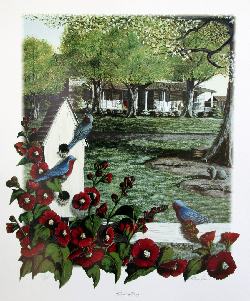 """Morning song"" is a spring scene featuring a bird house with three blue birds and some deep red Hollyhocks on a fence in front of a house in the distance."