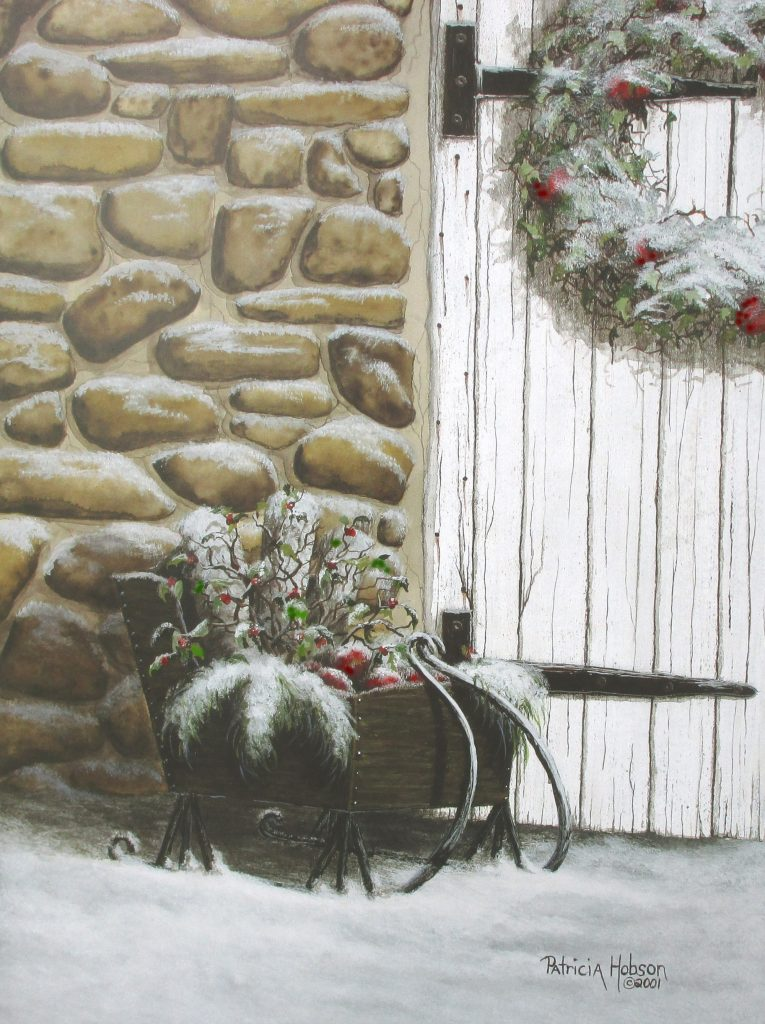 In this winter art print a tiny sleigh filled with greenery and apples sitting in the snow by a rock building with a wreath on the old door.