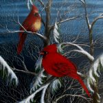 This winter art print featuring a pair of cardinals meeting on a pine tree on a snowy evening.