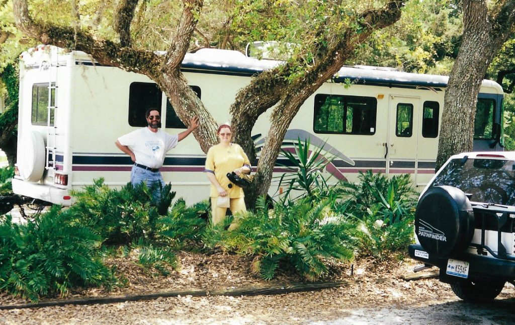 Patricia and Felix with their motorhome at the Crescent City, Fla. Catfish Festival