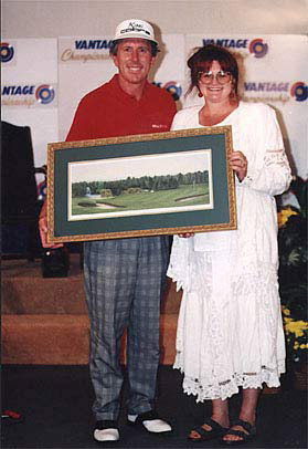 "1995, when the golf prints of ""The 18th Hole at Tanglewood"" were released, Hale Erwin was the championship winner. This is a picture of Patricia Hobson and Mr. Erwin."