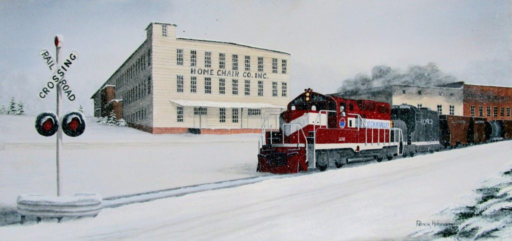 A small snow scene featuring the Yadkin valley Train as it steams by Home Chair Company in Rhonda, North Carolina.