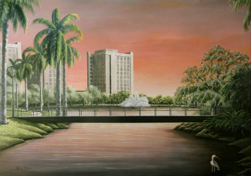 """""""Sunset at Lake Osceola"""" is a view of Lake Osceola on the campus the University of Miami with the walking bridge, fountain, dorms and of course the Ibis right up front."""