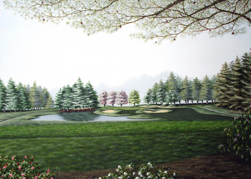 """""""12th Hole at Tanglewood"""" is a beautiful spring painting of the 12th hole at the Tanglewood Golf Course in Clemmons, North Carolina. In this view you are standing in the shade of a tree looking over pink, white and purple flowers looking toward the green. The Green, surrounded by sand traps, sits just to the right of a small lake. Beyond the green, are three pink flowering trees."""